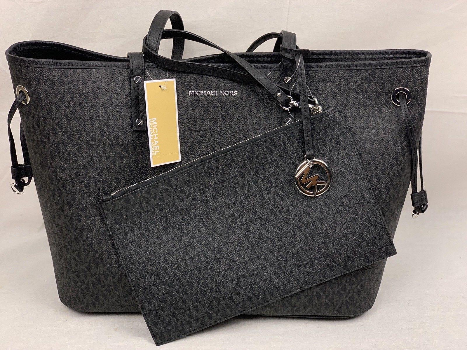 4efaa8075726 ... netherlands authentic michael kors jet set carryall signature black tote  3b69a 4448a