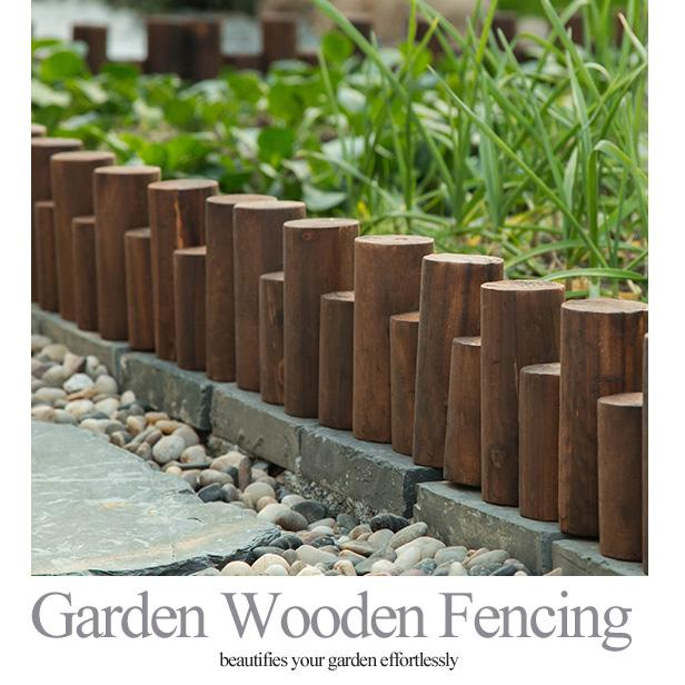Garden wooden fencing wood fence to create garden perimter or boundary natural logs